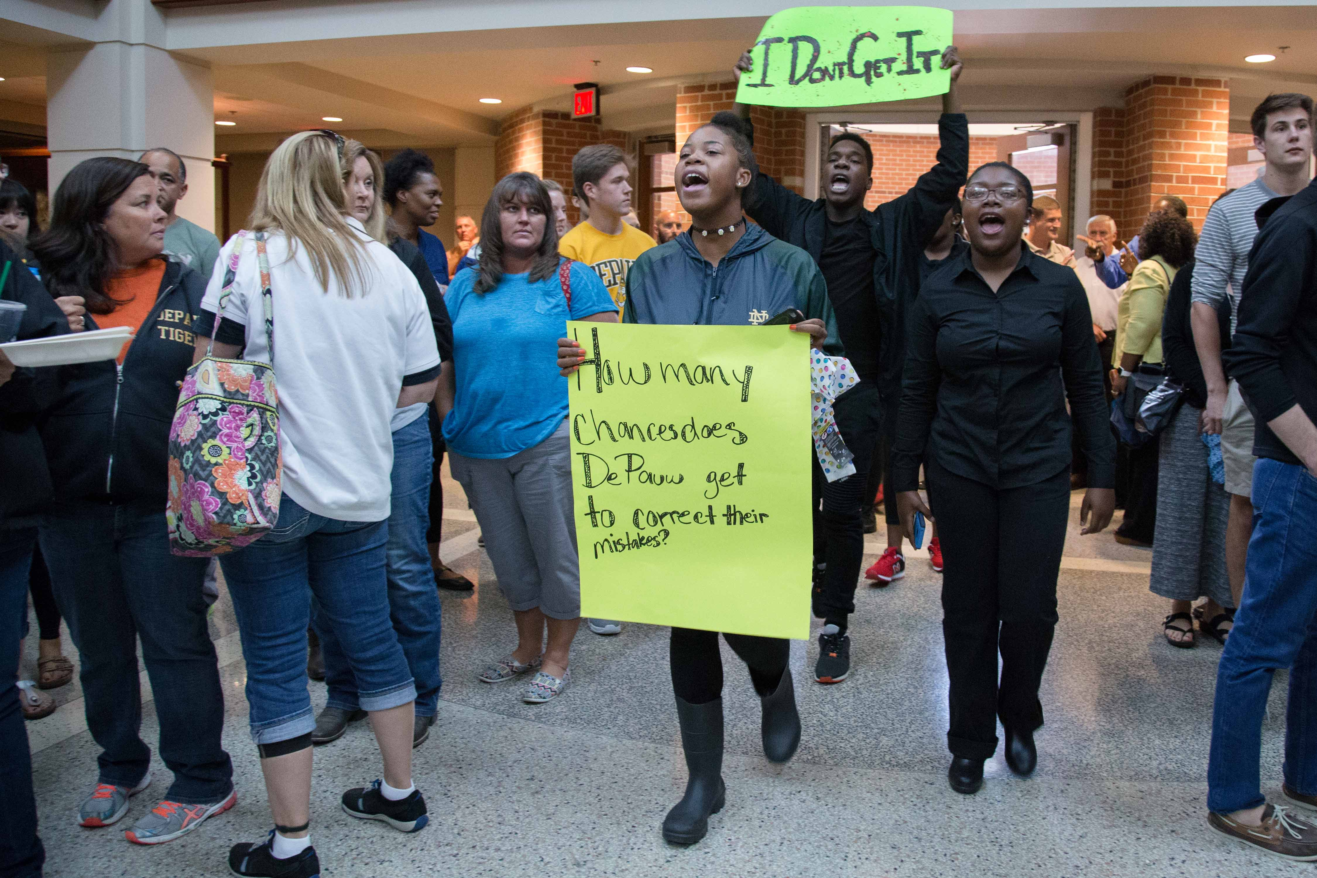Student demonstrators march and chant as they walk through the Percy L. Julian Science and Mathematics Center. The group chanted as they walked through the buildings serving lunch to DePauw Dialogue attendees. SAM CARAVANA / THE DEPAUW