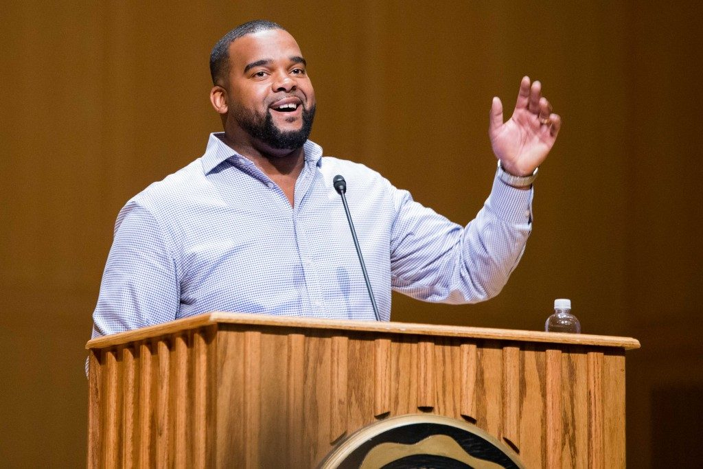 Charles Kuykendoll '09 speaks to freshman on Sunday night as  part of GOLD Alumni Speaker Series. Kuykendoll works for JPMorgan Chase & Co and is vice president of Suit Dreams, a nonprofit organization that gives suits to high school graduates of color in Chicago and New York.