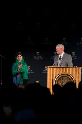 Malala waits to speak as crowd cheers