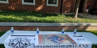 Interfaith Interns table outside of Asbury Hall